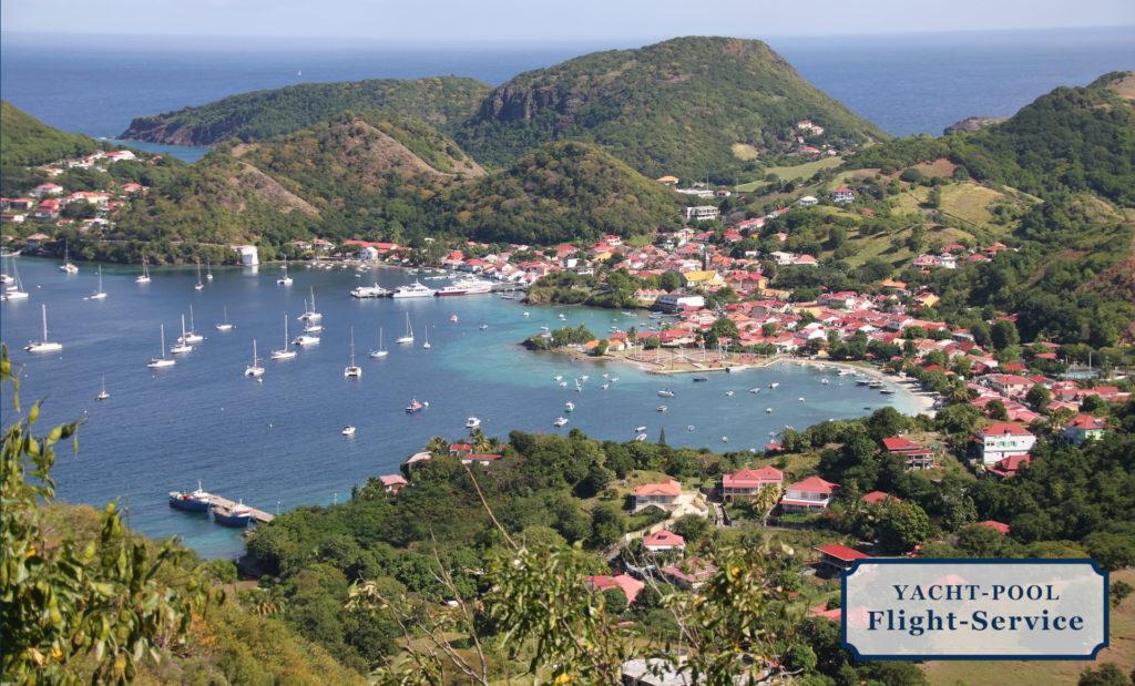 Guadeloupe in der Karibik. Weiße Standstrände, Segeln, Segeltörn, Regenwald, Vulkan, kleine Inselchen, Hafen, Karibik